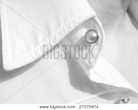 modern white shirt with pearly button and decolletage