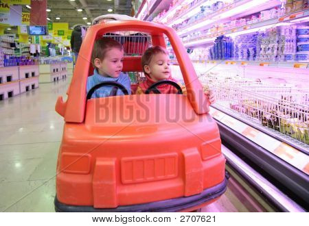 Children In Toy Automobile In Supermarket 3