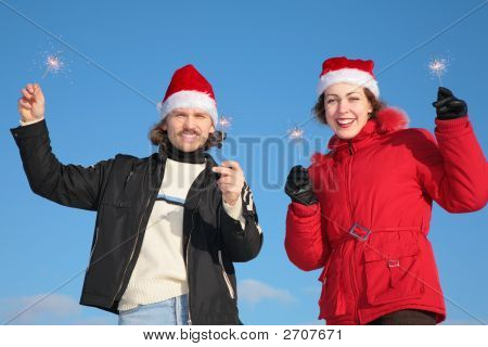 Couple Against Blue Sky Background In Winter