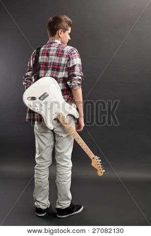Teenager Standing With Electric Guitar