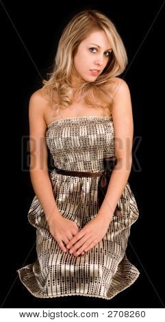 Beautiful Blonde Lady In A Beige Dress