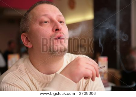 Smoking Man Releases Smoke From Mouth