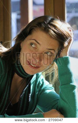 Attractive Female In A Coffe Shop