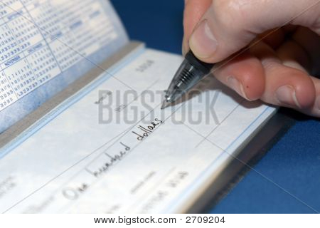 Closeup Of A Person Writing A Big Check