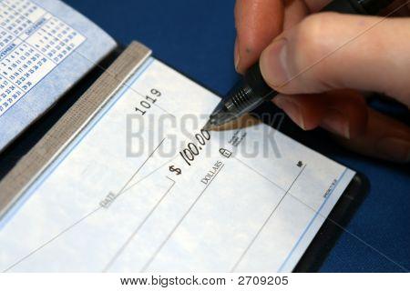 Closeup Of A Check Being Written