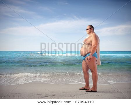 Fat man at the seaside