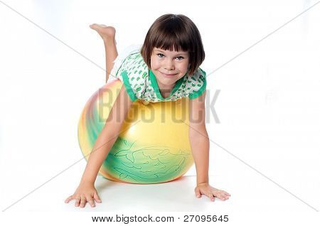little girl on a big ball isolated on a white background
