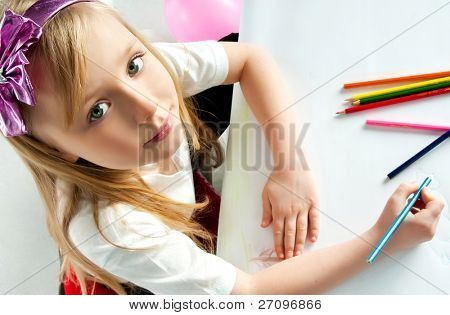 cute little girl with colored pencils