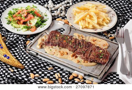 Tender meat with almond sauce.