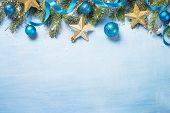 Christmas Background. Snow Fir Tree Branch, Blue Balls And Gold Star On Blue Background. Top View Wi poster