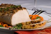 foto of roasted pork  - Delicious garlic thyme roast pork loin is ready for dinner - JPG