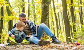 Parent Teach Baby. Father And Son Playing In The Autumn Forest. Little Boy With His Father In Autumn poster