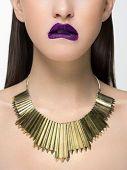 Close Up Glamorous Image Of A Female Predator With A Bite Of Purple Lips. On The Neck Are Golden Jew poster