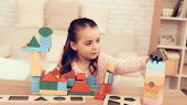 Little Girl Playing With Cubes. Educational Games. Learning Child At Home. Build House Of Cubes. Chi poster