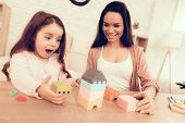 Mother Teaches Daughter. Educational Games. Learning Child At Home. Cost House Of Cubes. Cubes And P poster