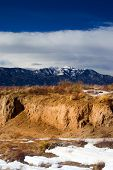 stock photo of colorado high country  - Winter among the southern Colorado high desert as the snowy Rockies stand in the background - JPG