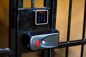 The Lock On The Iron Gate With A Hole For The Key And A Touch Panel For Entering The Access Key Or P poster
