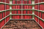 picture of book-shelf  - red hard cover book on shelf in old brick library - JPG