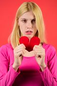 Sad Woman Tearing Paper Heart To Pieces. Attractive Blonde Girl Holds Broken Paper Red Valentine Hea poster