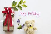 Happy Birthday Message Care Handwriting With Gift Box For Special And Teddy Bear On Background White poster