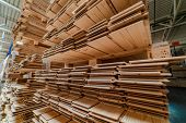 Racks With A Parquet Board Are In The Warehouse Of Factory. Manufacturing Of A Parquet Board. poster