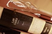 image of law-books  - Closeup of law books with glasses and pen - JPG