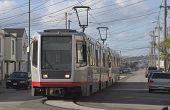 image of muni  - a group of light rail cars makes their way through san francisco - JPG