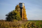 Water Tower In The Countryside At Sunrise. The Old Water Tower Provides Water To The Village. Water  poster