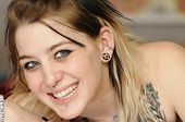stock photo of nose piercing  - Attractive female American with tattoo - JPG