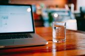 A Cup Of Pure Water With Laptop On Table. Royalty High Quality Free Stock Image Of Glass Of Pure Wat poster
