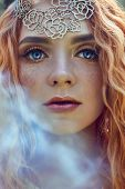 Beautiful Redhead Norwegian Girl With Big Eyes And Freckles On Face In The Forest. Portrait Of Redhe poster