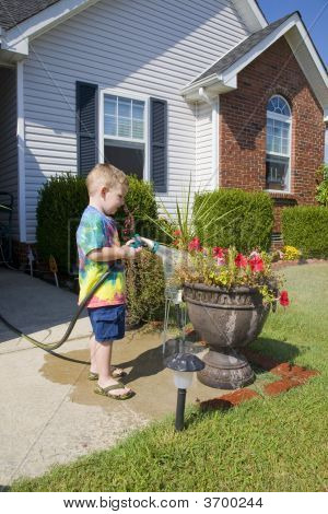 Child Watering Plants