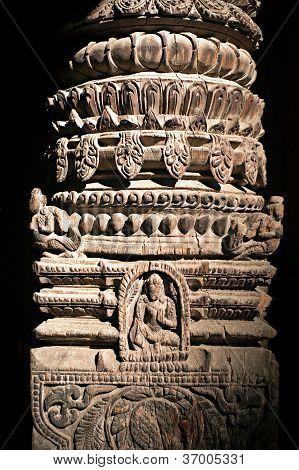Hindu temple architecture detail. Wooden column with Nepali Hindu God (Vishnu avatar)