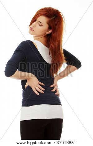 Woman heaving back ache, isolated on white background