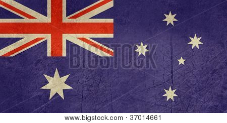 Grunge sovereign state flag of country of Australia in official colors.
