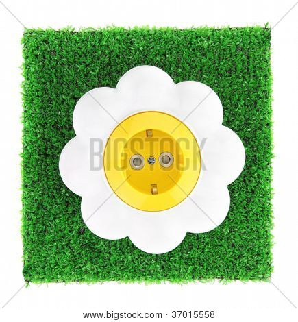 Alternative energy concept. Flower electrical outlet on grass