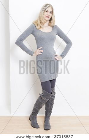 standing woman wearing fashionable gray boots
