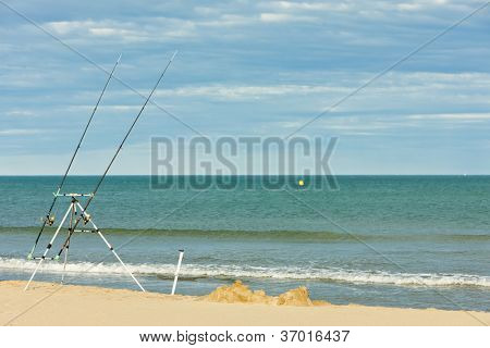 fishing rods on the beach in Narbonne Plage, Languedoc-Roussillon, France