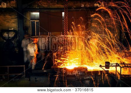 Pouring of liquid metal in open hearth workshop