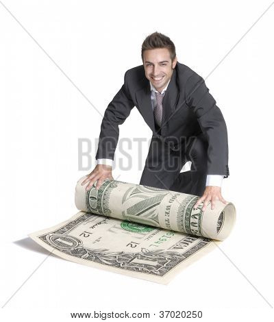 Young happy businessman rolling a big dollar bill.