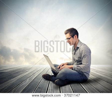 Man using his laptop computer