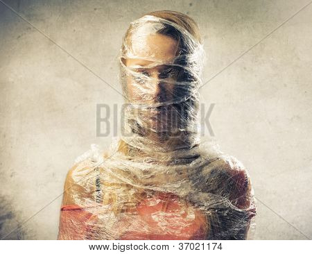 Blonde girl trapped in the plastic