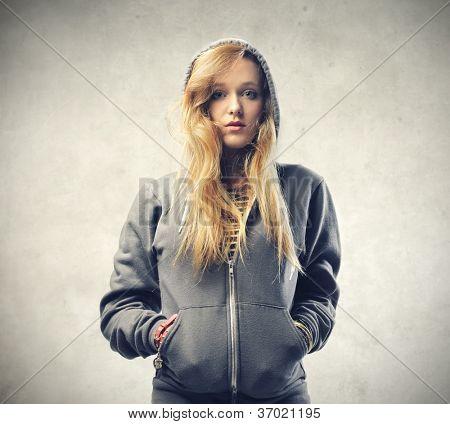 Beautiful blonde girl wearing a sweatshirt