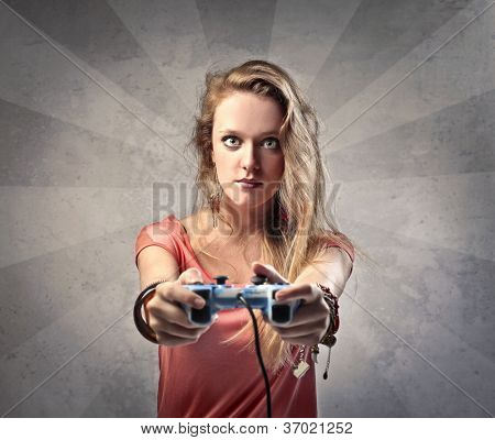 Beautiful blonde girl playing video games