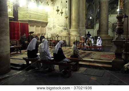 JERUSALEM - OCTOBER 04: Early in the morning before the arrival of pilgrims from around the world, nuns praying in the Church of the Holy Sepulchre, October 04, 2006 in Jerusalem, Israel.
