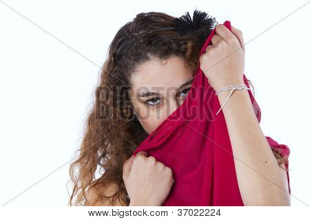 Young woman hiding her face with a red tissue (isolated on white)