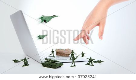 Computer security concept :  soldiers,tank,plane  are guarding a laptop from viruses, spyware and hacker with hand
