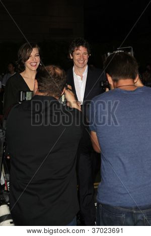 LOS ANGELES - SEP 12: Milla Jovovich, Paul W.S. Anderson at the LA premiere of 'Resident Evil: Retribution' at Regal Cinemas L.A. Live on September 12, 2012 in Los Angeles, California