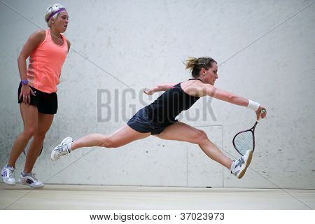 BUKIT JALIL, MALAYSIA - SEPTEMBER 11: Natalie Grinham defeats Lisa Aitken (orange) at the CIMB Malaysian Open Squash Championship 2012 on September 11, 2012 at the National Squash Centre, Malaysia.