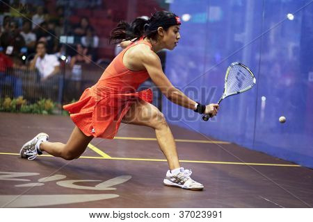 DAMANSARA - SEP 14:Nicol David plays a return shot during the women's semi-final match of the CIMB Malaysian Open Squash Championships 2012 held in Damansara, Malaysia on September 14, 2012.